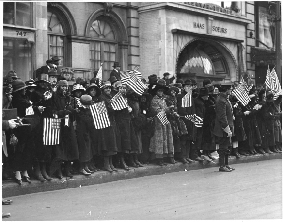 Crowds waiting for the parade of the famous 369th [African American] Infantry, formerly 15th New York regulars, New York City. From the U.S. National Archives.